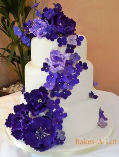 "The colors. The purple flowers on this cake made me say, ""The...colors..."" very slowly, as if I were simultaneously floating from a morphine IV drip and taking Ecstasy. Those deep shades of purple just satisfy my brain."