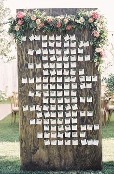 wood escort card board as an organic contrast to mirrors