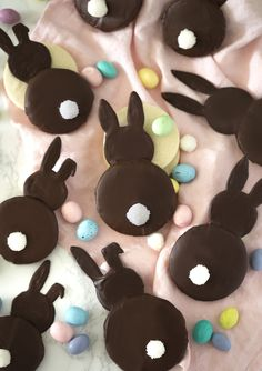 My chocolate bunny cookies are a really fun holiday treat and if nothing else I think you'll love the no-spread sugar cookie recipe! You can totally make white or even pink bunnies with this recipe by substituting the chocolate for a white candy melt. Don't try to use white chocolate, you'll end up in tears. The fluffy tales are really fun to make; you're just rolling a little ball of fondant and coating it in sanding sugar. I've attached a photo of the outline I drew for ...