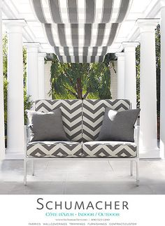 Antibes chevron in oxford grey, cannes awning stripe in oxford grey, throw pillows paloma herringbone, and beaufort settee by mckinnon & harris schumacher