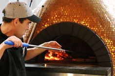 """Brass colored """"penny"""" tile mosaics dress this spectacular pizza oven -- www.hudsontilesupply.com Fire Pit Oven, Fire Pits, Brick Ovens, Tile Mosaics, Penny Tile, Cool Restaurant, Pizza Ovens, Wood Fired Oven, Carp"""