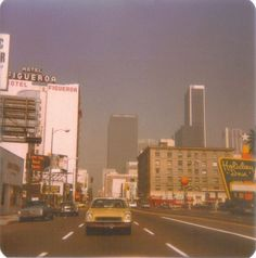 Figueroa Street, Downtown Los Angeles, 1977 by nick There's that same yellow-orange my Comet was. And sadly, the reality of horrible smog some days. Aesthetic Vintage, Aesthetic Photo, Aesthetic Pictures, 1970s Aesthetic, California Camping, Downtown Los Angeles, Images Esthétiques, Mellow Yellow, 1970s
