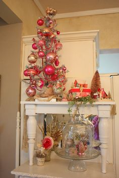Christmas decorating: stacked end tables to create open spaces and add height! Love it!