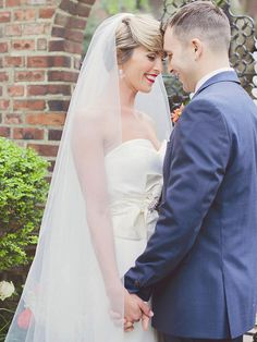 A classic cathedral-length veil is a graceful and luxe way to showcase short hairstyles.