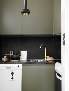 Stylish Modern Apartment With Cork And Wood In Decor - DigsDigs Olive Kitchen, Green Kitchen, New Kitchen, Kitchen Dining, Kitchen Decor, Dining Room Design, Interior Design Kitchen, Home Design, Kitchen Cabinet Colors