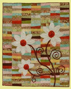 beautiful quilts  I thought with that new tonal brick background this would give you ideas!