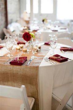 Cozy guest table w/ burlap runner and cranberry napkins; mason jar centerpiece