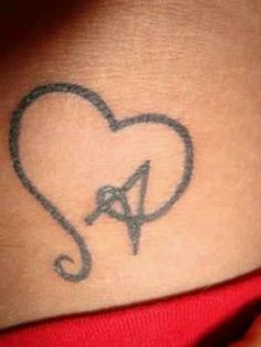 initial heart tattoo...maybe this is what I should do around my ankle...each of the hearts could be linked  I could have each of my nephews initials done...