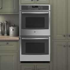 The GE Built In Double Convection Wall Oven. The Piece Is Built With  Durable Stainless Steel And Features A Flat Black Finish For A Streamlined  Look.