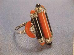 Bague en platine, corail, onyx et diamants, Cartier, 1933