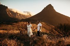 engagement shoot lions head table mountain cape town south africa cape town wedding photographer fiance husband and wife elopement white dress sunset clouds Lions Head Cape Town, Cape Town South Africa, Photoshoot Inspiration, Couple Shoot, Wedding Photoshoot, Engagement Shoots, Beautiful Images, Table Mountain, Till Death