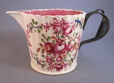 Floral pearlware cream jug c. 1800 with tin replacement handle via Past Imperfect: the art of inventive repair