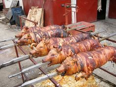 Belgrade, Serbia: whole pig on a stick is a traditional way of preparing pork in Serbia: roasted and smoked meat is a custom feast for Serbs.
