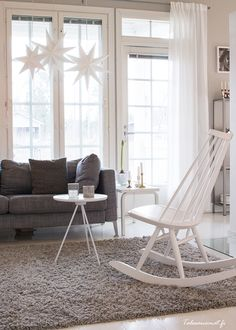 Living room, gray sofa, white rocking chair, stars, christmas, scandinavian