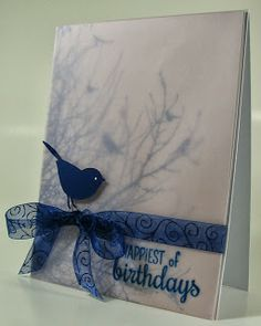 handmade birthday card for Seize the Birthday challenge ... deep blue and white ... silhouette birds stamped on main panel and covered with vellam ... organdy ribbon, little die cut bird and stamped sentiment on top ... great planning puts the bird in the tree ...