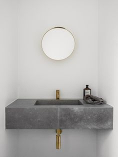 Norm Architects resurrect a historic Copenhagen Apartment that once housed Danish Designer Poul Henningsen and was devastated by fire, for a classically modern and minimal family abode. Bad Inspiration, Bathroom Inspiration, Interior Inspiration, Bathroom Colors, Small Bathroom, Bathroom Grey, Bathroom Ideas, Bathroom Modern, Brass Bathroom