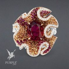 "Check this very unique ""Froufrou Rubis"" ring in pink and white gold diamonds rubies and spessartite garnets by"