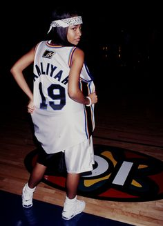The NBA Playoffs has me thinking back to MTV's Rock N' Jock and the early days of celebrity sports style, epitomized here by the late, great Aaliyah. celebrity sports style, epitomized here by the late, great Aaliyah. Rock Style, Rock Chic, My Style, Hip Hop Style, Glam Rock, Rip Aaliyah, Aaliyah Style, Aaliyah Outfits, Aaliyah Costume