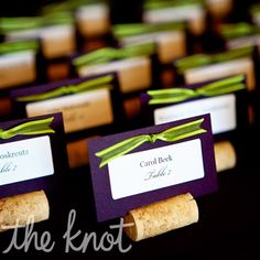 winery-themed escort card display, Lindsay took care of the cards and bows while Seth flattened the bottoms of the corks and made slits down the middle with a saw. DIY