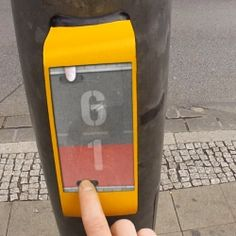 Streetpong is an interactive game to play while waiting for the walk signal.