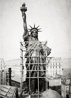 The Statue of Liberty towers over the Paris rooftops in 1884 before being shipped to New York. Photo: AP.