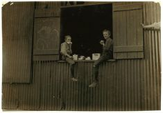1908 the young kids working .Lunch Time, Economy Glass Works by Lewis Hine