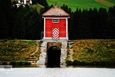 The red house between two lakes by mauribrego  alps lake lenzerheide mountains red switzerland mauribrego