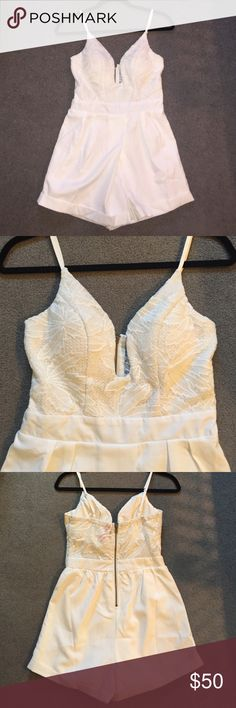 White Lace Romper White romper with lace detailing on the top. Has a plunging neckline, fitted at the waist and has pleated bottoms. This is a size 8 in AU which is equivalent to a size small. Hello Molly Fashion Pants Jumpsuits & Rompers