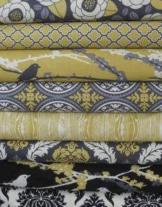 i like the patterns of these fabrics. just replace black with turquoise for my family room couch pillows :)