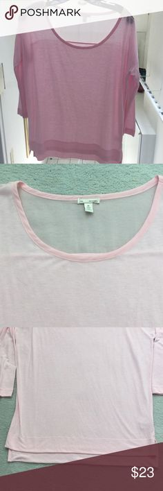 Soft pink top, sheer yoke across back shoulders. Soft pink top, sheer yoke across back shoulders (about 4 in ) . Back slightly longer than the front. Worn maybe twice . Perfect ! GAP Tops Blouses