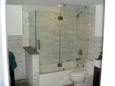 classic looking tub withframeless glass door - Google Search