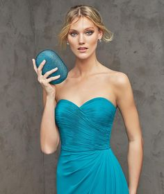 FREYA- Long flared cocktail dress in blue georgette. Draped bodice with sweetheart neckline. Asymmetric skirt with draping at the side.