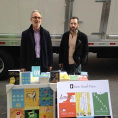 """Michael Z. Wise (l.) and Ross Ufberg, cofounders of New Vessel Press, at the publisher's pop-up in New York City on November 23. The publisher has put on four pop-up stores over the past year, and plans on three more before the end of 2014. """"Although our books are distributed by Consortium Book Sales & Distribution and are in stores around the country, we're working hard to bring our books, translated from many languages around the world, to as many readers as possible,"""" said Wise."""