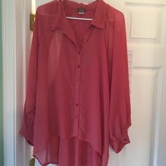 Long sleeve, chiffon type blouse. This is a beautiful pink blouse with a lace panel back. Dots Tops Blouses