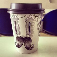 "Drawing On Creativity - Chilean illustrator Kartess has named this furry-mouth guy, ""Senor Vaso."" Drawing on coffee cups has also been trendy among artists such as Brock Davis, Cheeming Boey, and Tomoko Shintani. Coffee Cup Drawing, Coffee Cup Art, Coffee Cup Design, Coffee Milk, Moustache Design, Starbucks Cup Art, Mediums Of Art, Coffee Branding, Art Pictures"