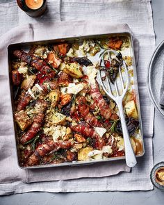 Pigs-in-blankets traybake Types Of Potatoes, Potato Onion, Parmesan Potatoes, Roasting Tins, Pigs In A Blanket, Delicious Magazine, Make Ahead Meals, Melted Cheese, Bacon Wrapped