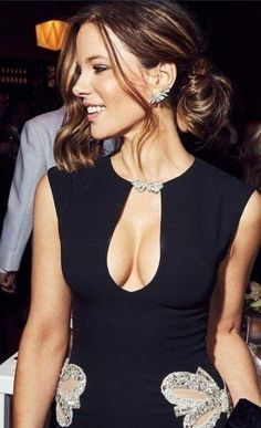 fd8703e4b4c The gorgeous actress Kate Beckinsale in a tight cleavage revealing black  sexy dress.