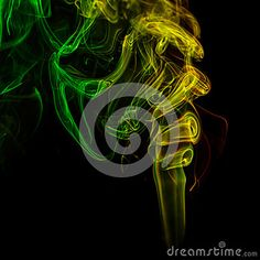 Abstract art. Color yellow-green smoke from the aromatic sticks on a black background. Background for Halloween. Texture fog. Design element. The concept of aromatherapy.