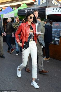 Kendall Jenner wearing Adidas by Raf Simons Stan Smith Sneakers, Made Gold Betty Jeans and Gucci Marmont Camera Mini Quilted Leather Shoulder Bag