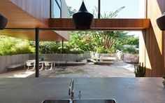 flipped house in Sydney by MCK. Love that the kitchen opens out to patio area with built in seating