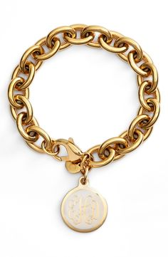 This gold chain-link bracelet looks especially timeless with its decoratively monogrammed charm.