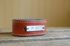 GO RUN brown leather cuff with stitching