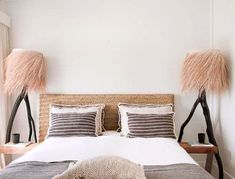 woven headboard and unique floor lamps with fiber lampshades. / sfgirlbybay