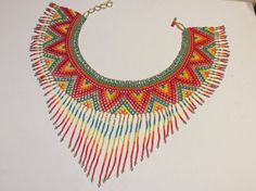 Rainbow colors, glass seed beads, hand beaded collar necklace with fringe. Absolutely stunning.....statement piece for an amazing price.