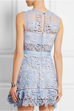 Self-Portrait powder-blue mini-dress. It's crafted from floral guipure lace and is lined with a stone stretch-jersey bandeau and mini skirt for coverage. To complement the pastel hue pair with silver accessories.