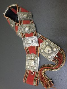 Woman's belt. Christian (Assyrian), from Iraqi Kurdistan, ca. 1900. Silver plates on a woollen woven belt. (Source: Peter Hoesli).
