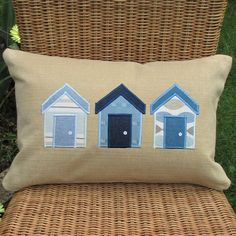 Beach huts cushion - Rectangular, beige with blue and white huts £12.00