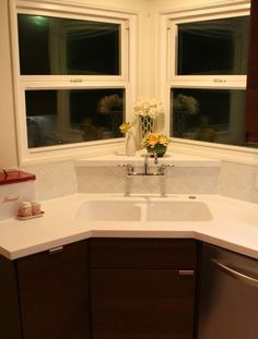 My sink is positioned just like this. I put in a gooseneck faucet, but I think I may change it out to THIS. No pooling water around the bases. Nice.