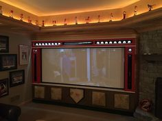 A home theater with a Cincinnati Reds theme completed by Hanson Audio Video. #housetrends https://www.housetrends.com/specialist/Hanson-Audio-Video--Cincinnati