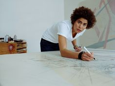 "Women in Africa and the Diaspora: ""Julie Mehretu""      ""I don't think of architectural language as just a metaphor about space, but about spaces of power, about ideas of power."""